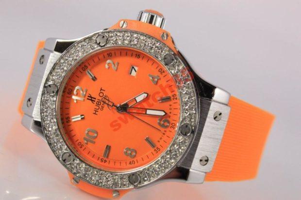 модные женские часы: оранжевые с серебром
