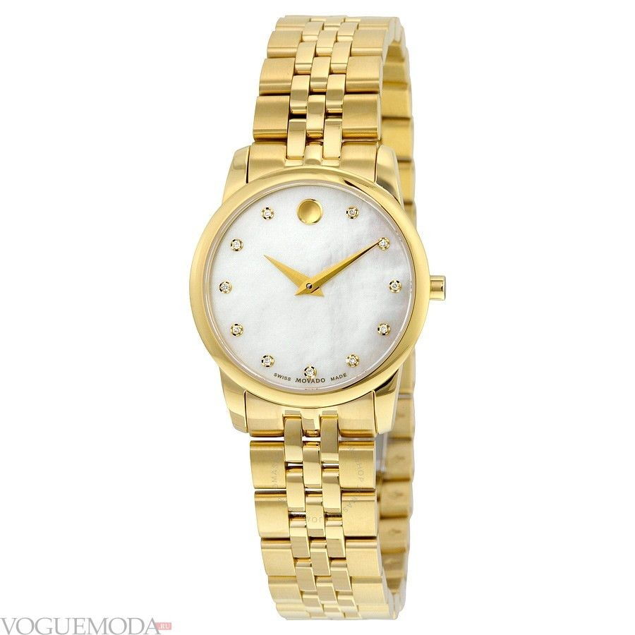 часы с круглым циферблатом и золотым ремешком