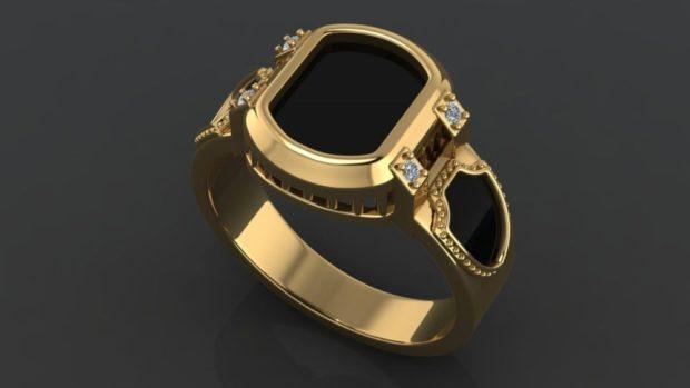 золотой с черным камнем