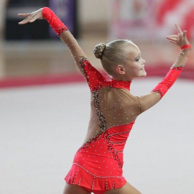 купальник художественная гимнастика 2018-2019: красный с черным рукав длинный
