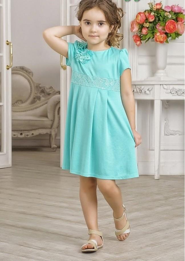 бирюзовое платье с цветком на плече