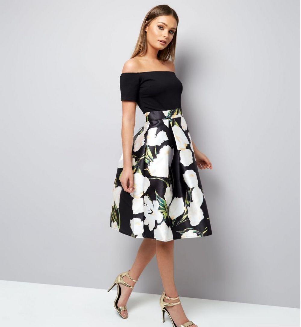 летние женские образы 2018: юбка-солнце черная в белые цветы