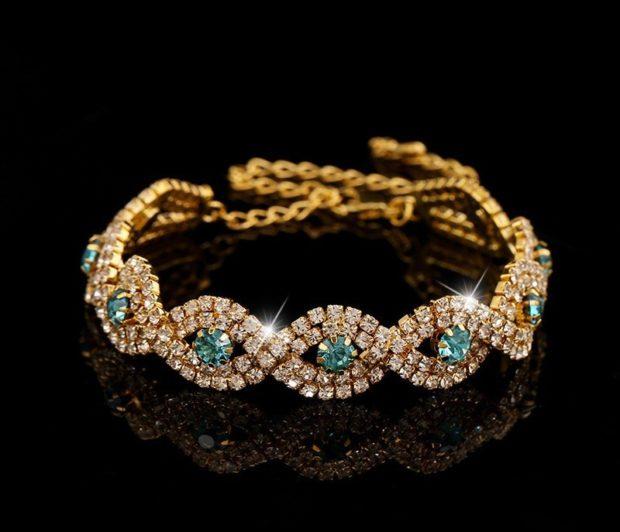 золотой браслет с камнями драгоценными