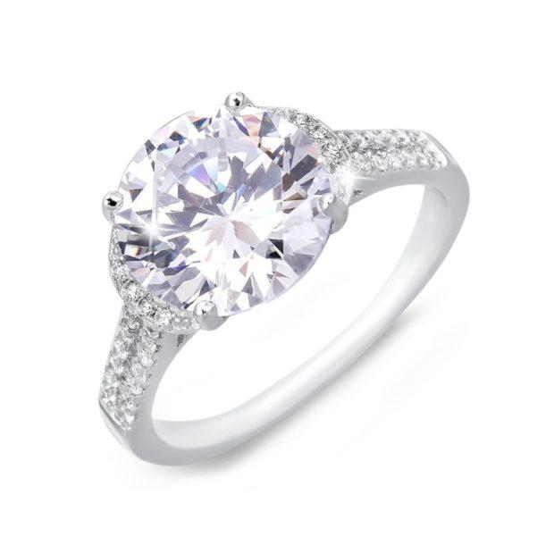 кольцо обручальное женское из белого золота с камнем большим и мелкой россыпью
