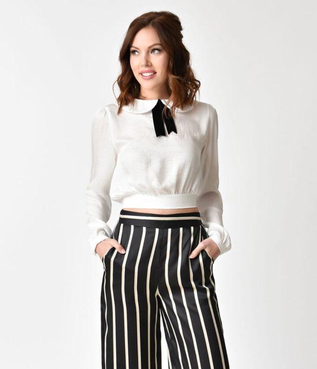Мода весна лето 2021 для женщин за 40: брюки в полоску и белая блуза с бантом