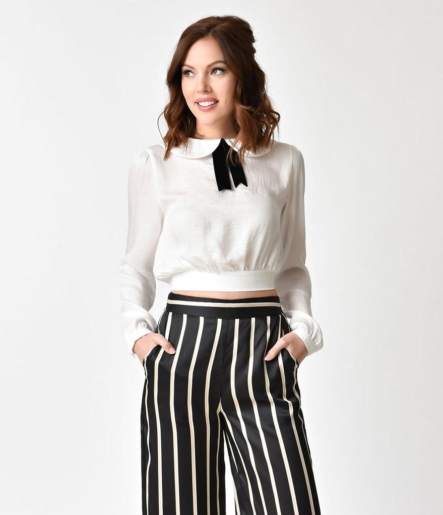 брюки в полоску и белая блуза с бантом
