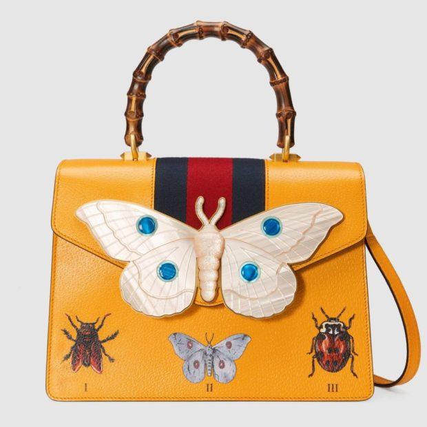 желтая сумка с животными мотивами